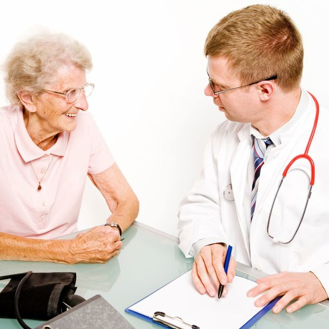 Memory Care editorial image of doctor and female patient.